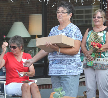 Teresa Winkler accepts handmade rose from_Jo Woodward and Susan Arnold